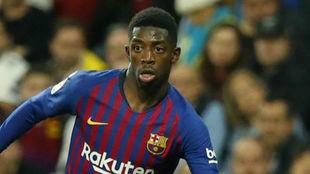 Dembelé, durante un partido con el Barcelona