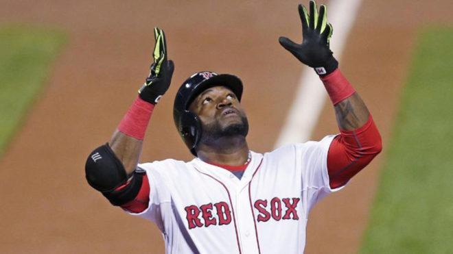 David Ortiz festeja un jonrón con los Boston Red Sox.