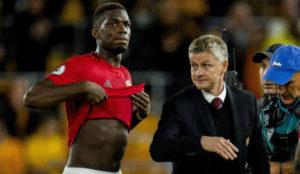 Pogba y Solskjaer tras el empate ante el Wolverhampton