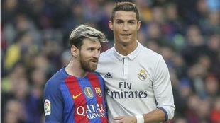 Messi y Cristiano, durante un duelo entre el Barcelona y el Real...