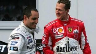 Juan Pablo Montoya y Michael Schumacher.