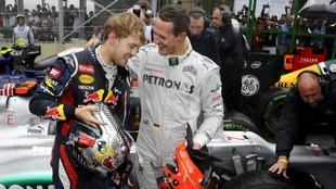 Sebastian Vettel junto a Michael Schumacher.