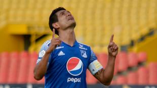 David Mackalister Silva celebra un gol con Millonarios.