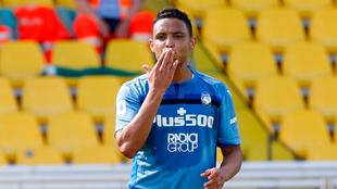 Luis Fernando Muriel celebra uno de sus goles contra el Parma.